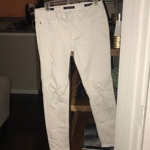 A pair of white skinny jeans